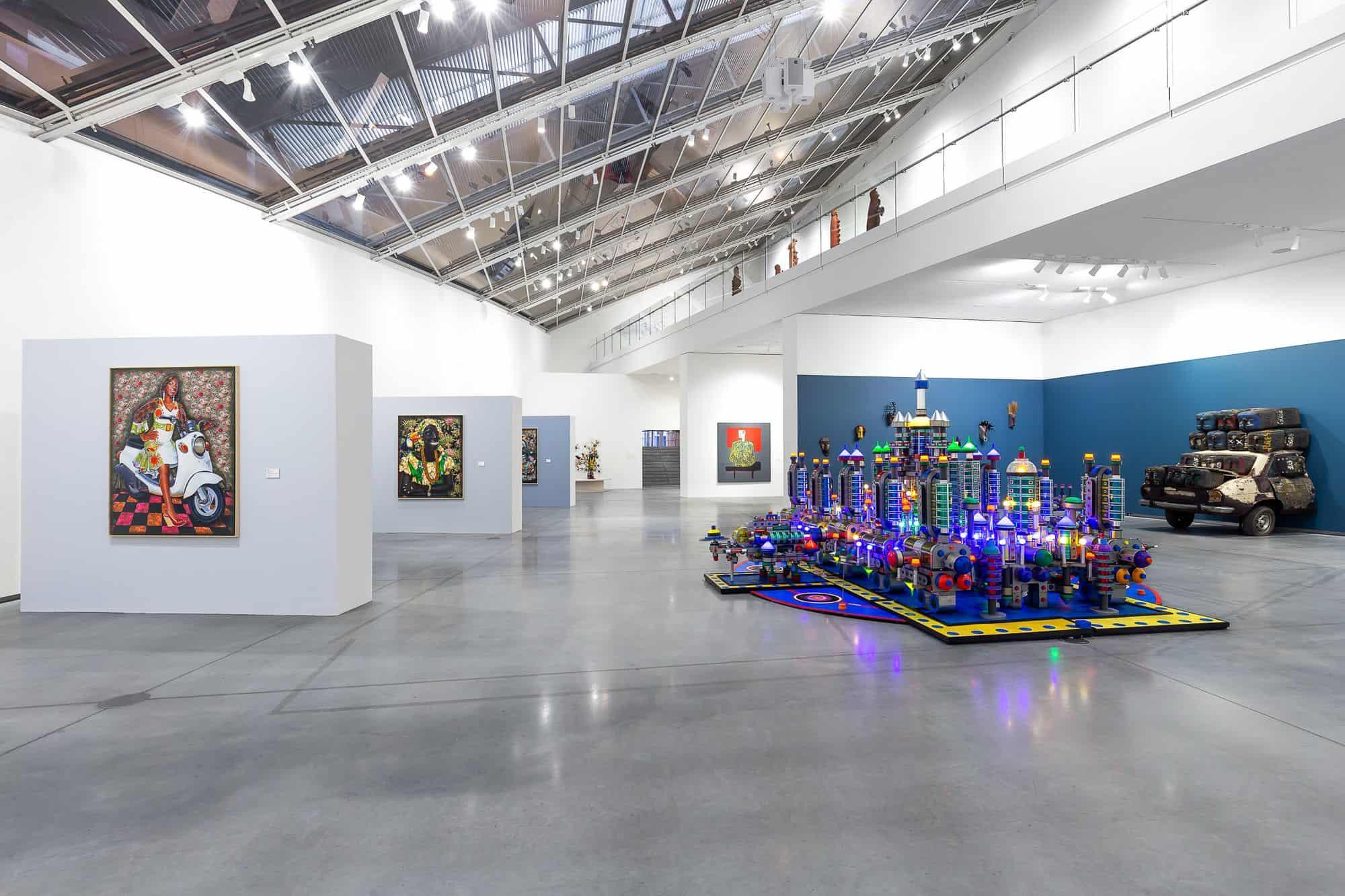 """Shown, At right RIGOBERT NIMI, """"Galaxie, la ville du futur,"""" 2015-17 and ROMUALD HAZOUMÉ, """"Elf rien à foutre,"""" 2005.   Photo courtesy Astrup Fearnley Museum"""