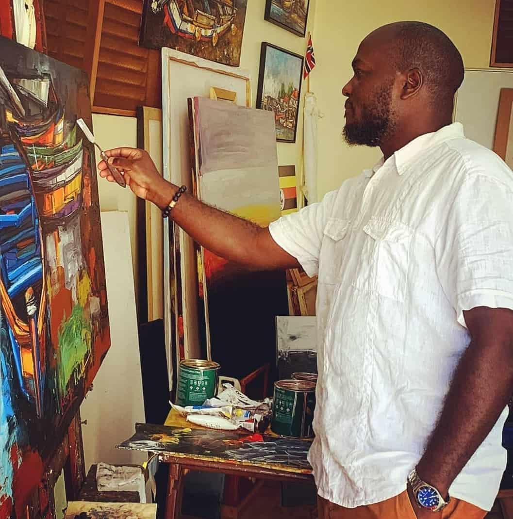 Ugandan Artist Cliff Kibuuka at work in his studio